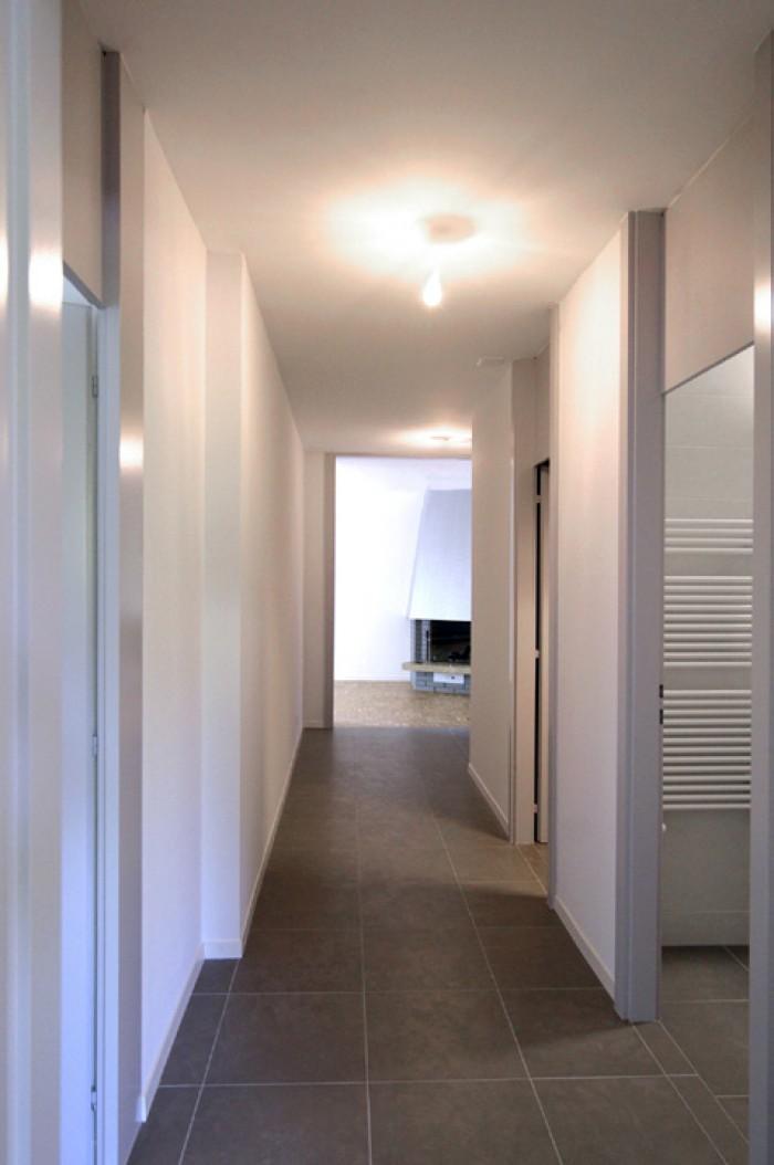 Caudoz Pully rénovation transformation d'un appartement PPE couloir distribution